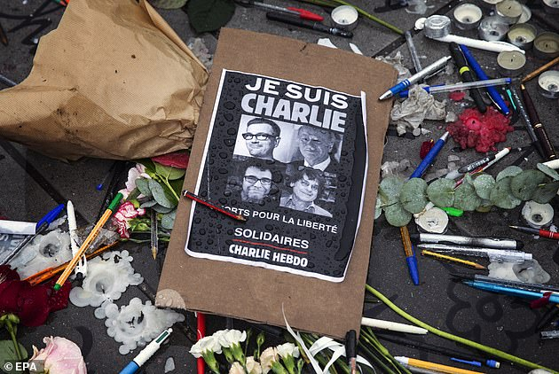 A message of solidarity with Charlie Hebdo - containing the popular slogan 'je suis Charlie' (meaning 'I am Charlie') - is laid out in Paris after the attack in 2015