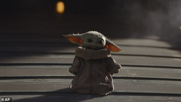 Too cute to take: The Baby Yoda, whom the Mandalorian is protecting, is the breakout star of the popular series