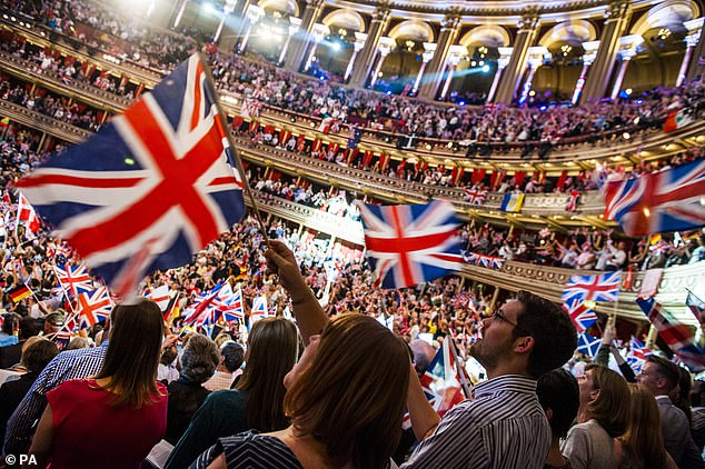 Pictured: The audience enjoying the BBC Last Night of the Proms, at the Royal Albert Hall. Land Of Hope And Glory and Rule Britannia! will be performed at this years' Last Night Of The Proms