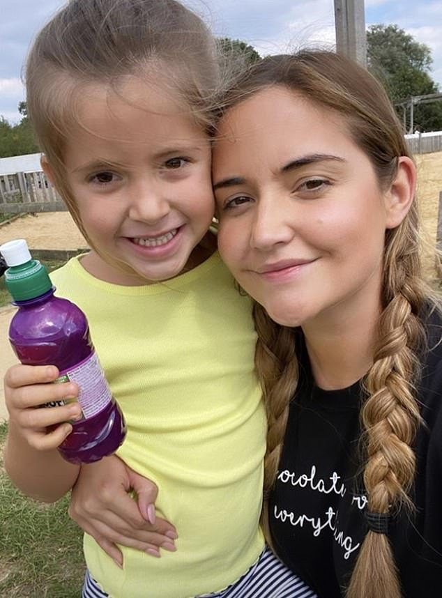 Sweet! Elle smiled excitedly for a selfie with her mum