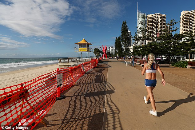 Modelling by Tourism Research Australia predicted Australia's tourism industry will be worth $83.8 billion in 2020-21, some $54.6billion less than in 2019. Pictured: The Gold Coast
