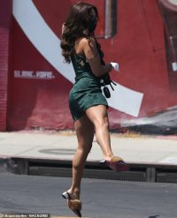 Vanessa Hudgens puts dancer's legs on display as she leaps into air while out with gal pal GG Magree