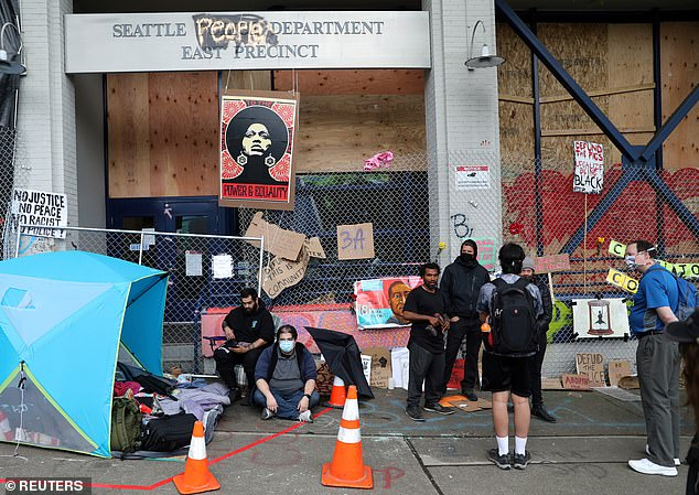 The comandeered Seattle Police East Precinct is seen within the CHAZ in June