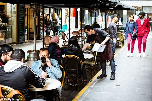 The study found big alcohol drinkers, who also drink coffee (pictured, cafes on Degraves Street in Melbourne before Stage Four restrictions) were less likely to develop cirrhosis