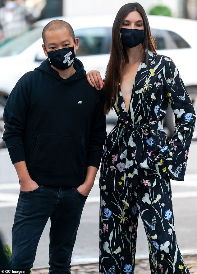 Street style: Fashion designer Jason Wu and modelJacquelyn Jablonski pose for a photoshoot in Midtown Manhattan on Wednesday. Both sporting Jason Wu designs, the pair stopped traffic as they had a glamorous socially distanced fashion shoot