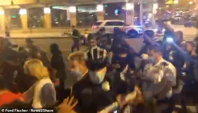 Crowds of people tussled with law enforcement, and one officer had to go to hospital