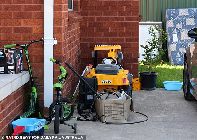 The boy's toys sat idly out the front of the woman's red-brick Cabramatta rental this week