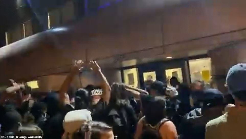 Black Lives Matter D.C. tweeted: 'Don't let MPD control the narrative! Police lie! We're on our way.' Footage shows protesters confronting officers outside a police precinct