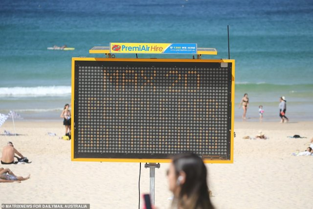 A sign at Bondi Beach warns beachgoers there is a maximum of 20 people allowed per group at the beach