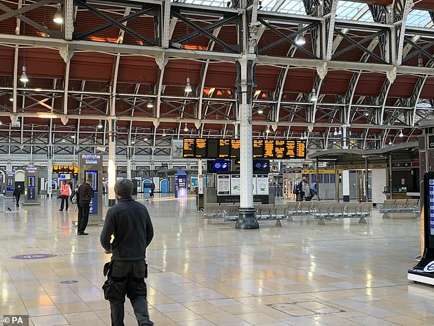 A nearly empty concourse at London Paddington train station yesterday morning