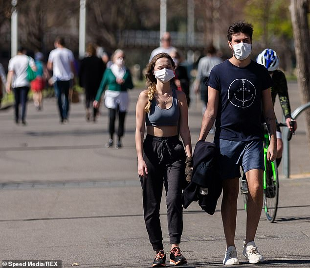 The Australian National University's latest survey foundloneliness, psychological distress and worry surrounding potential job losses had increased from May to August. Pictured: Melburnians walking in public with masks on