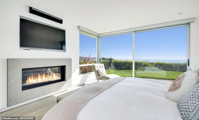 At peace:Living in the lap of tranquillity, the media personality's master bedroom has a built-in fireplace system, twin cabinets and a state-of-the-art TV for cosy nights in