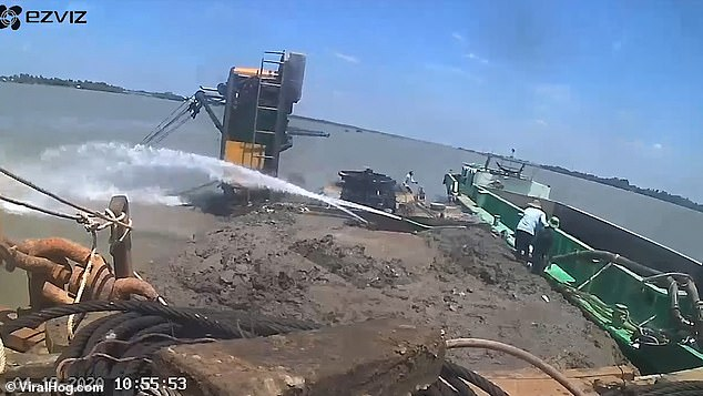 The crane was working on the Co Chien River in Vinh Long, Vietnam, when a particularly heavy load sent the machine crashing into the water