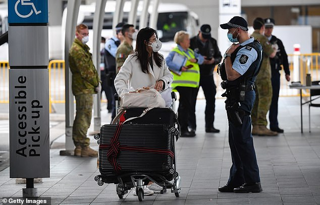 Australians will have to wait until at least December 17 before they fly go overseas again. (Pictured: a returned traveller at Sydney International Airport on August 8)