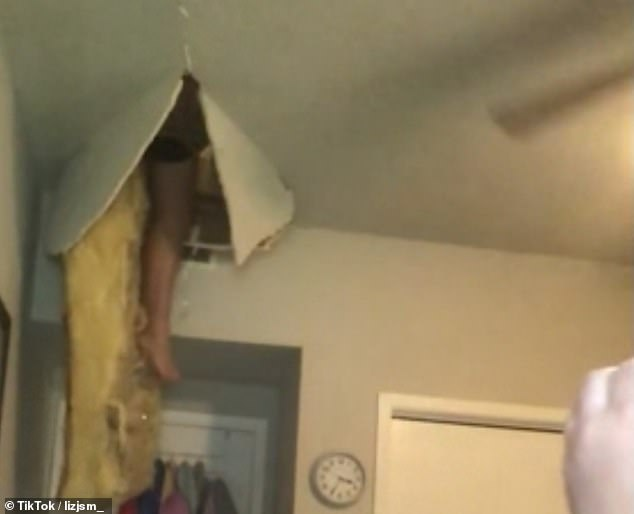 As she turned around she shouted 'Oh my God' as she realised her mother's leg dangled down into the room