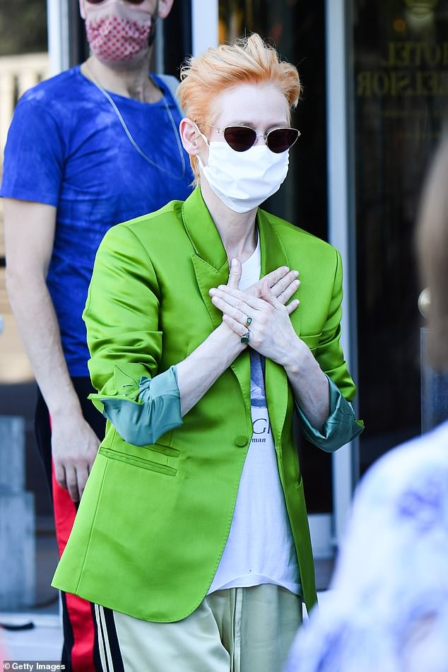 Safety first:She also made sure to slip on a face mask as she made her way through the crowds to her first stop of the day