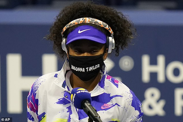 Naomi Osaka wears a face mask bearing the name of Breonna Taylor, who was shot dead by police in Louisville in March