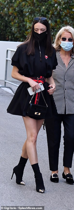 She added a red and black belt to emphasise her waist