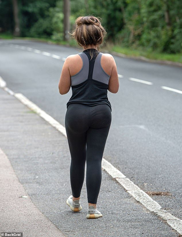 Cheeky! She was showing off her famous derriere in her leggings