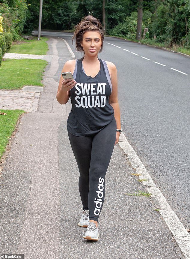 Working hard:The former TOWIE star, 33, looked stunning in her workout gear as she emerged in the top reading 'Sweat Squad' paired with trendy Adidas leggings