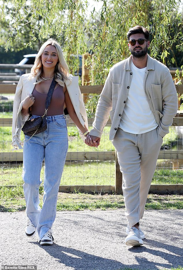 Loved-up: The couple packed on the PDA as they strolled hand-in-hand around the pig farm before later joining Liam 'Gatsby' Blackwell and James 'Diags' Bennewith