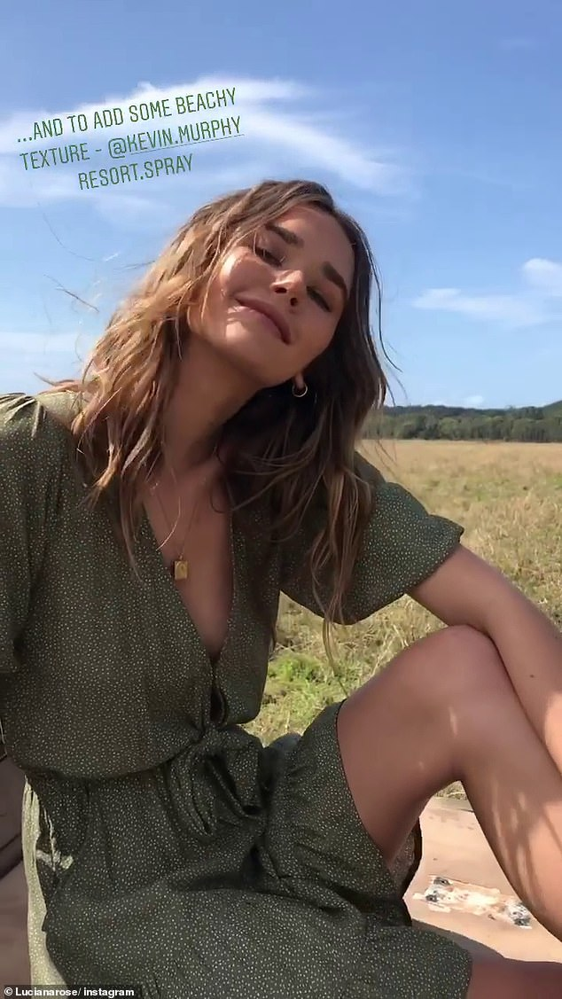 Prints charming: A third and final video showed the stunning model in a green and white patterned dress with a plunging neckline and tie waist