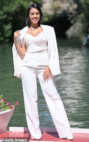 Sensational: Georgina showcased her toned figure in a white trouser suit