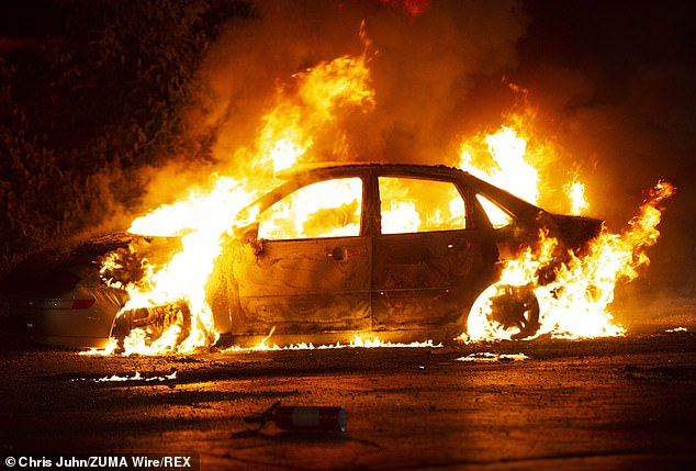 A car on fire on August 26 in Kenosha. Anger at Blake's shooting, captured on video that went viral, led to street skirmishes with protesters hurling firecrackers and bricks at police in riot gear who fired volleys of tear gas and rubber bullets