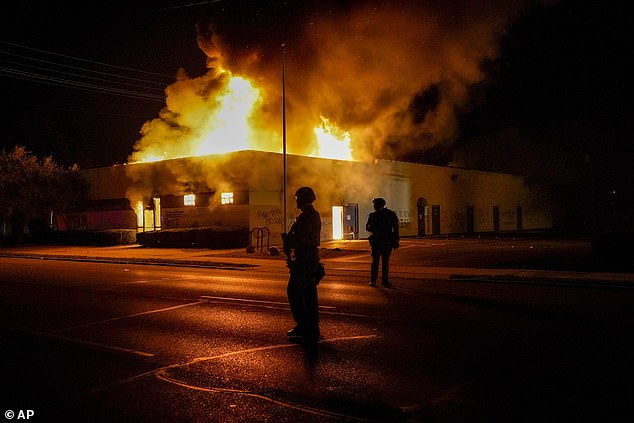 Kenosha, Wisconsin, emerged as the latest flashpoint in a summer of US demonstrations against police brutality and racism. Pictured: A department of corrections building that was on fire during protests