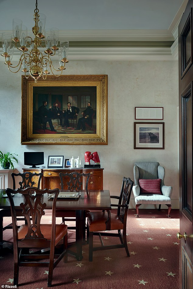 Eat up: In the private dining room (pictured) was an 1868 Civil War painting, a pair of Muhammad Ali's boxing gloves, and framed notes from a speech by JFK