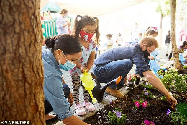 Prince Harry and Meghan Markle plant flowers during an LA pre-school visit last weekend