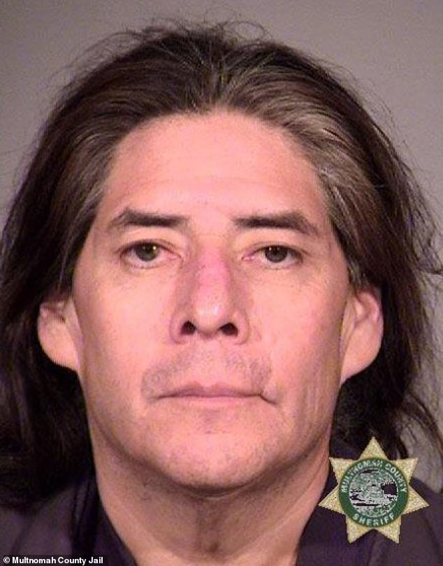 Lonnie Vantewa Albert, 55, (pictured) was driving along Interstate 84 in Portland, Oregon on Sunday when he allegedly purposefully drove into the officers' vehicle