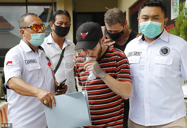 Denpasar Police allege Coyle (back right) acted as a drug runner for British man Collum Park, 32, (centre)