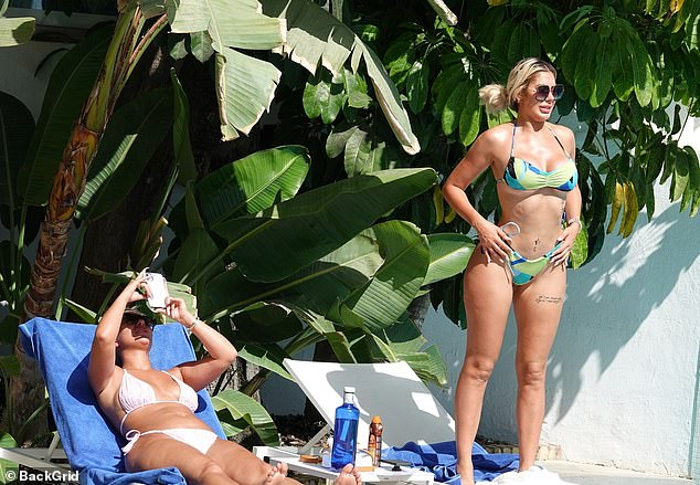 Cleavage: The reality star paraded her svelte waist and surgically-enhanced assets in the plunging halterneck top