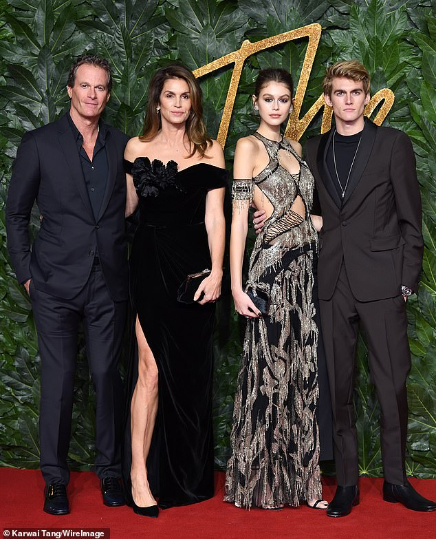 2018 family portrait:Nineties supermodel Cindy Crawford (2-L) and Casamigos co-founder Rande Gerber's (L) son Presley (R) 'is doing better' since his rebellious streak, and it's partly due to the coronavirus quarantine keeping him out of trouble