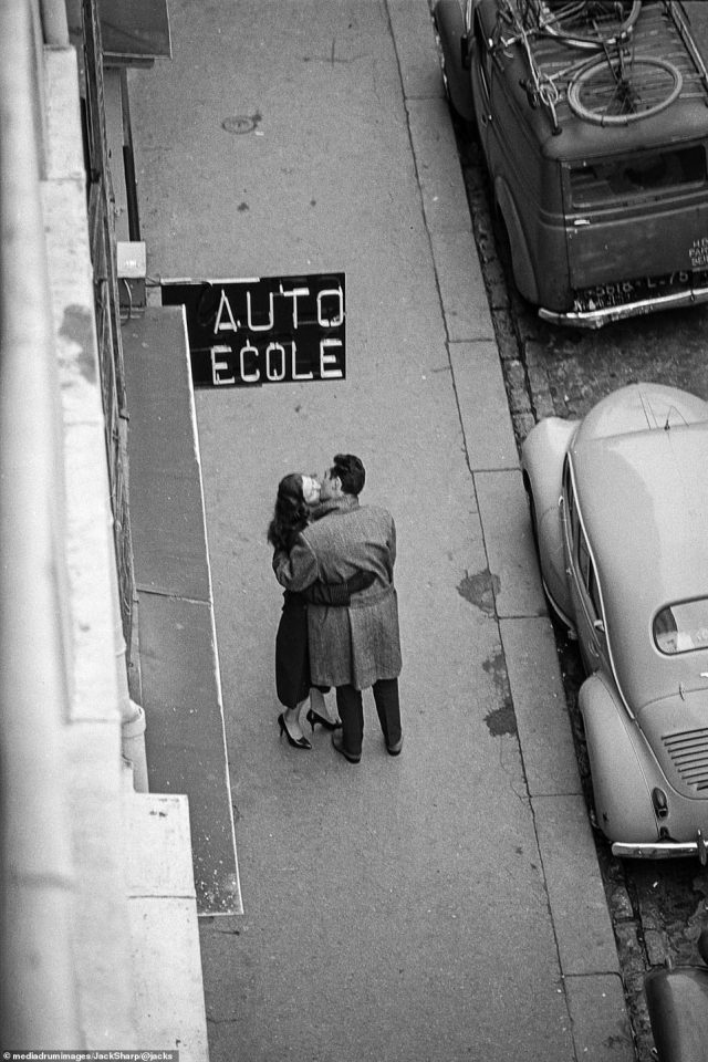 Love in Paris, captured from the edge of a building in Rue du Montparnasse. Sharp passed away in 1992 - one year before his grandson's birth. However, Dylan, who took his middle name from the photographer, has started a website in Jack's honour where he hopes to raise funds for Alzheimer's and cancer research