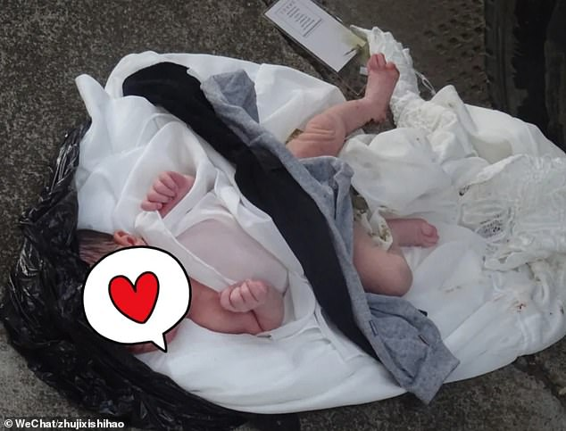 The naked girl was lying inside a black plastic bag when she was discovered on the street by a passer-by who heard the baby crying in Zhuji city of eastern Chinese province Zhejiang