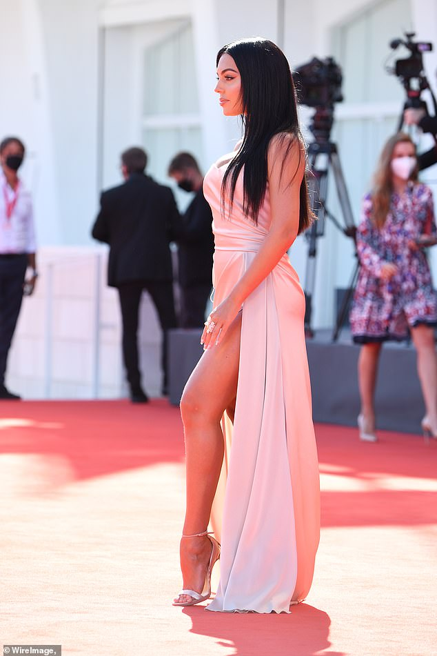 Pink lady: The elegant dress made the most of her stunning figure