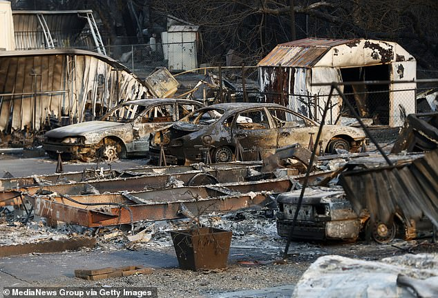 The fires have led to eight fatalities and the destruction of more than 3,100 structures. Scorched cars and trailres pictured at the Spanish Flat Mobile Villa trailer park in Lake Berryessa, California on August 26