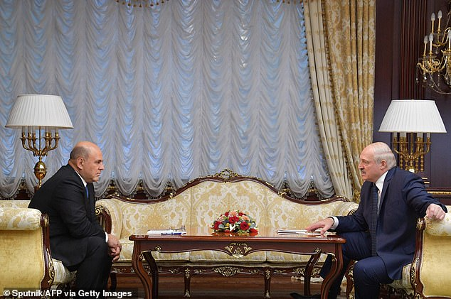 'There was no poisoning of Navalny,' Lukashenko told a poker-faced Mishustin during their televised meeting, pictured above