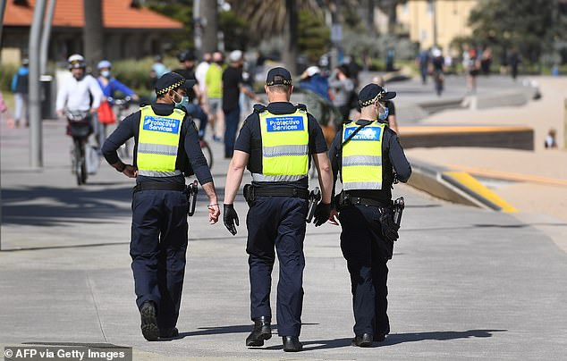 Protective services officers patrol along the St Kilda Beach foreshore in Melbourne on Thursday