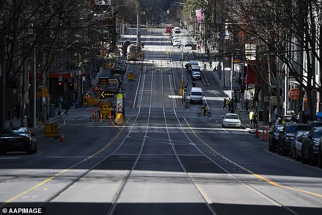 Pictured: A general view of La Trobe Street in Melbourne during Stage Four lockdown on Thursday