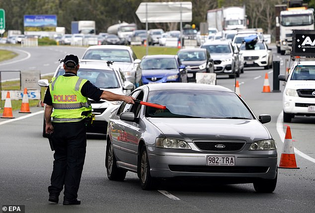 Queensland deems all of Victoria, NSW and ACT to be coronavirus 'hotspots' and all travellers from those locations are required to spend 14 days in hotel quarantine at their own expense. Pictured: Motorists at the Coolangatta checkpoint before Queensland closed to NSW
