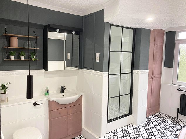 The mirror's frame has been spray painted black giving it a modern appearance, and a sleek black light fitting added along with spotlights