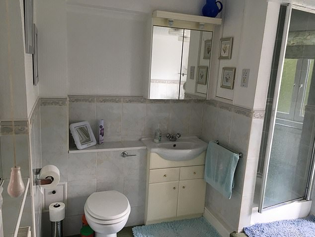 The bathroom before was drab and dreary, with cream coloured cabinets - now painted in Sulking Room Pink paint