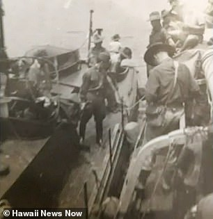 One of three pictures shows the Japanese arriving on a boat