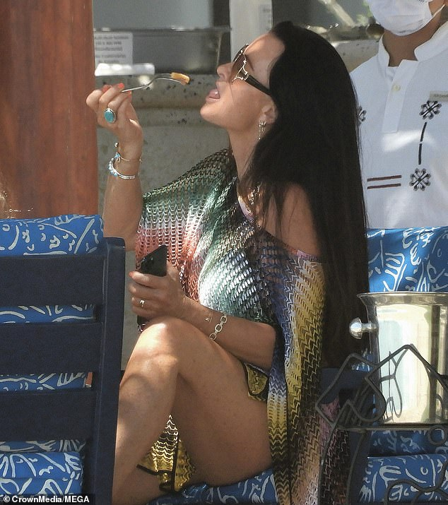 Lapping it up: The reality star was seen chowing down on food while on her luxury trip
