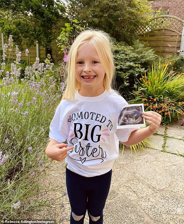 Promotion!She also added an adorable snap of Summer, holding the sonogram, wearing a 'Promoted To Big Sister' top