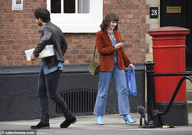 Funky: Meanwhile Alexandra Roach sported a 70s-inspired look, including denim flared dungarees and a brown velvet blazer