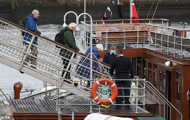 An ambulance, fire engine and helicopter are at the scene and the number of passengers aboard is not yet known. Pictured: Guests are welcomed on board the Paddle steamer Waverley on August 22